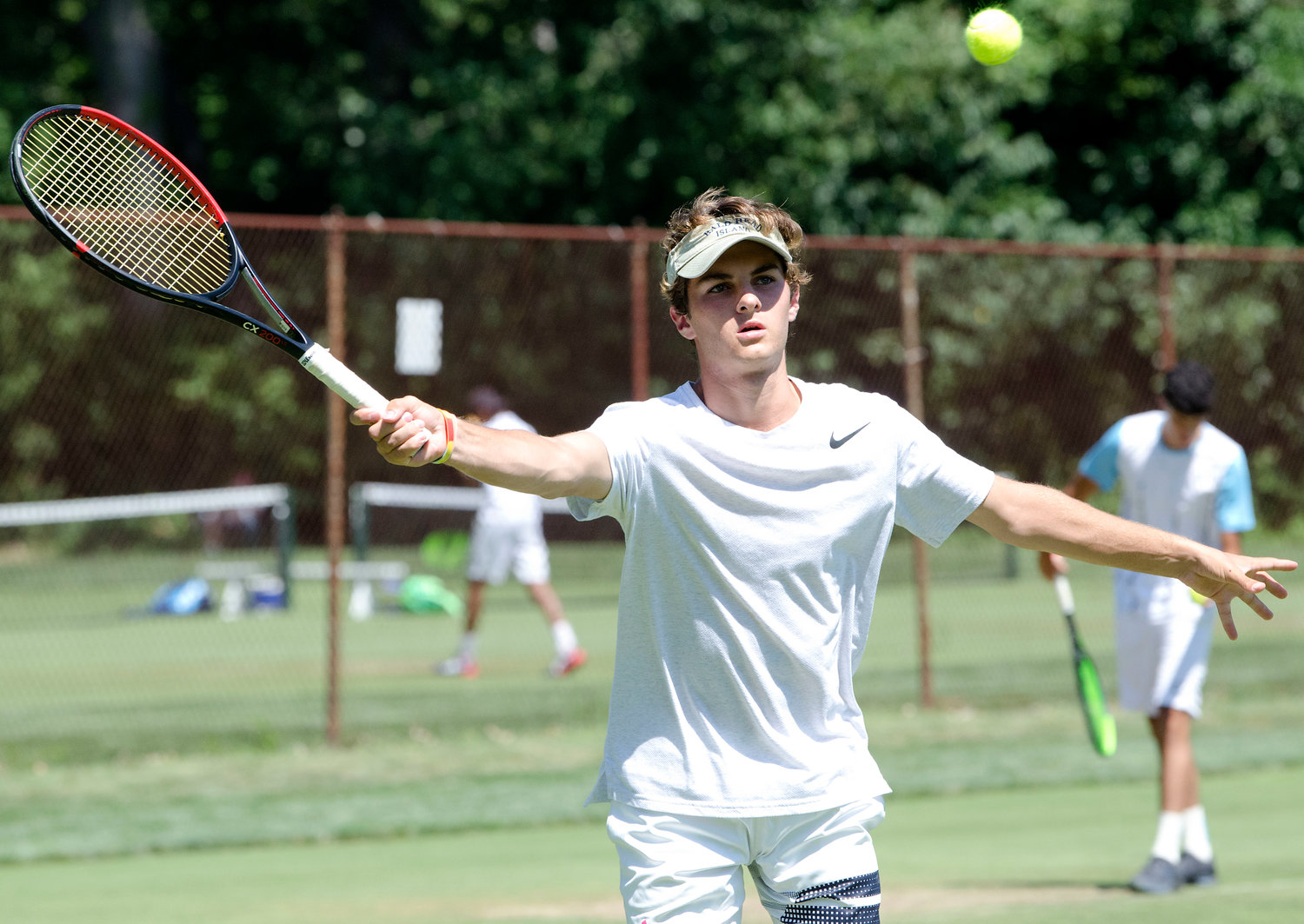 Alex Visser competes in singles at the Second Annual New England Grass Court Open Tourney.