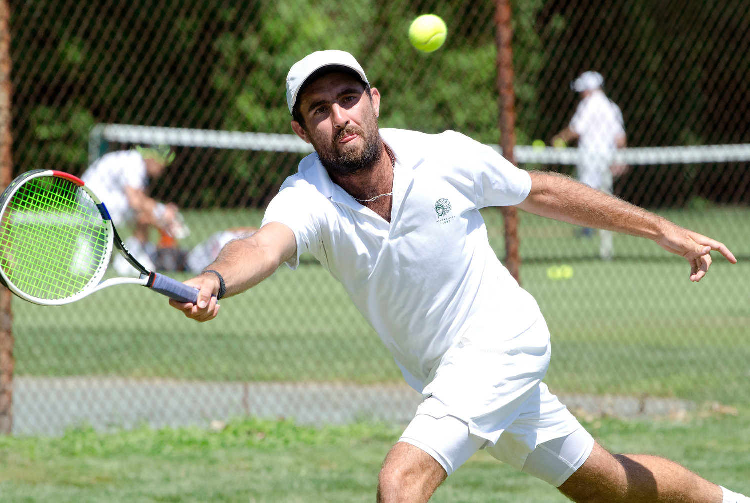 Agawam Hunt Director of Racquets Dana Parziale reaches for a volley during singles play in the Second Annual New England Grass Court Open Tourney played at the club over the weekend, August 7-9. Parziale won the doubles draw with club member Evan Ambrose.