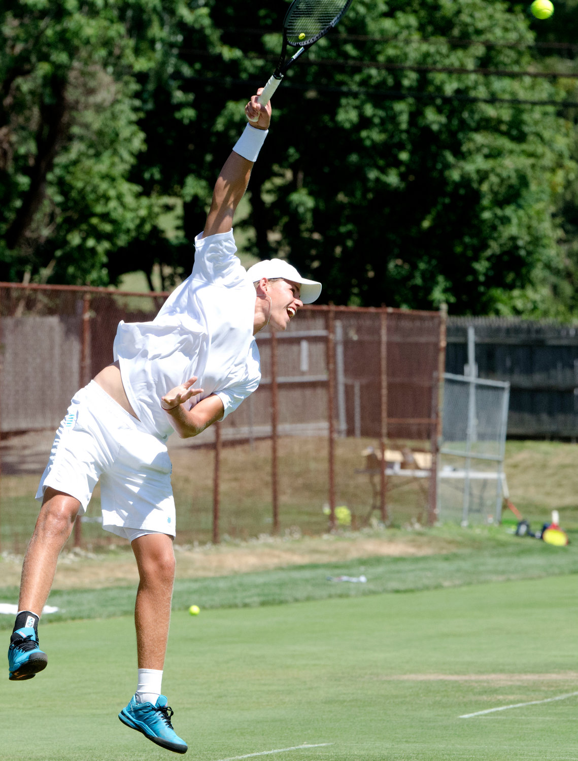 Danny Milvasky serves during singles play in the Second Annual New England Grass Court Open Tourney at the Agawam Hunt Club. Milvasky would later suffer a broken ankle in his semifinal match against eventual champion Matt Kuhar.