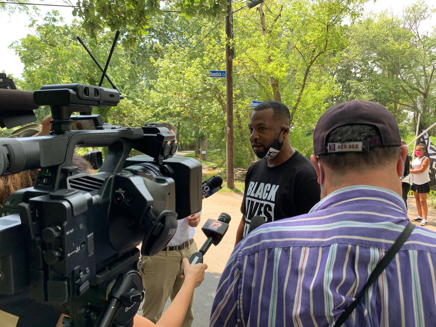 Black Lives Matter organizer Mark Fisher talks to the media at Rumstick Point Tuesday afternoon.