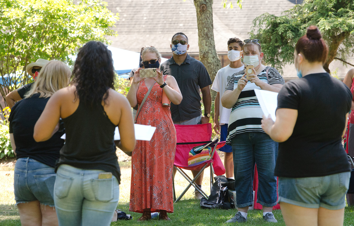 Parents look on as the JDP A Capella group sings during the Looff-East Providence Arts Festival at Hunts Mill on Saturday, Aug. 8.