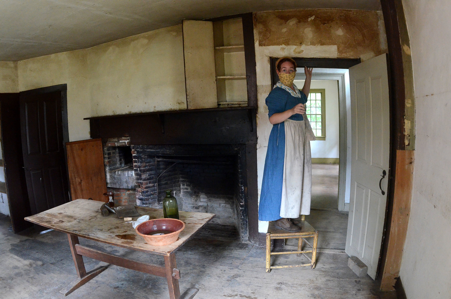 Coggeshall Farm program coordinator Eleanor Langham washes the walls in the main building with vinegar and water.