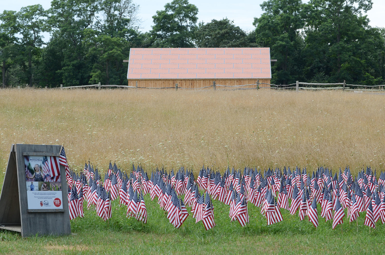 Coggeshall Farm's new Field of Flags, with new barn in the background, honors military personnel, veterans and first-responders.