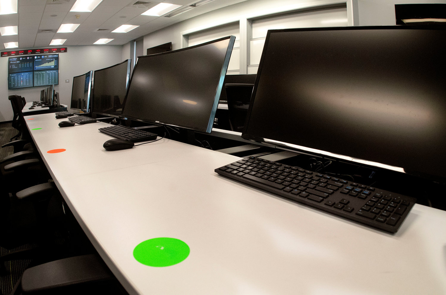 A classroom in the Gabelli School of Business building uses green dots to identify where a student may sit, and red dots or no dots to identify where a student cannot sit during class.