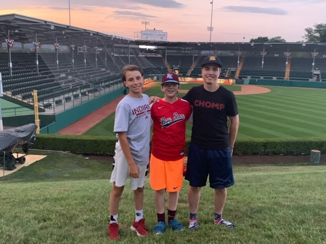 Gabe, Lucas and Sam Tanous (from left to right) pose for a photo outside one of the fields at the Little League World Series in Williamsport, Pa.