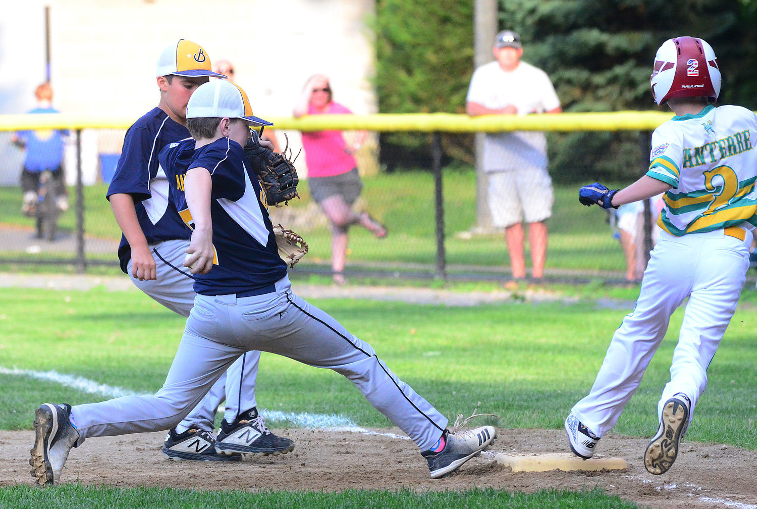 Lucas Tanous steps on first base just before a Bristol player reaches the bag.