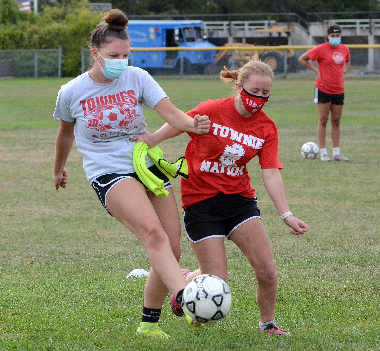 Townies Julia Rocha and Kayla Hannon tussle for control of the ball during a recent EPHS girls' soccer team practice.