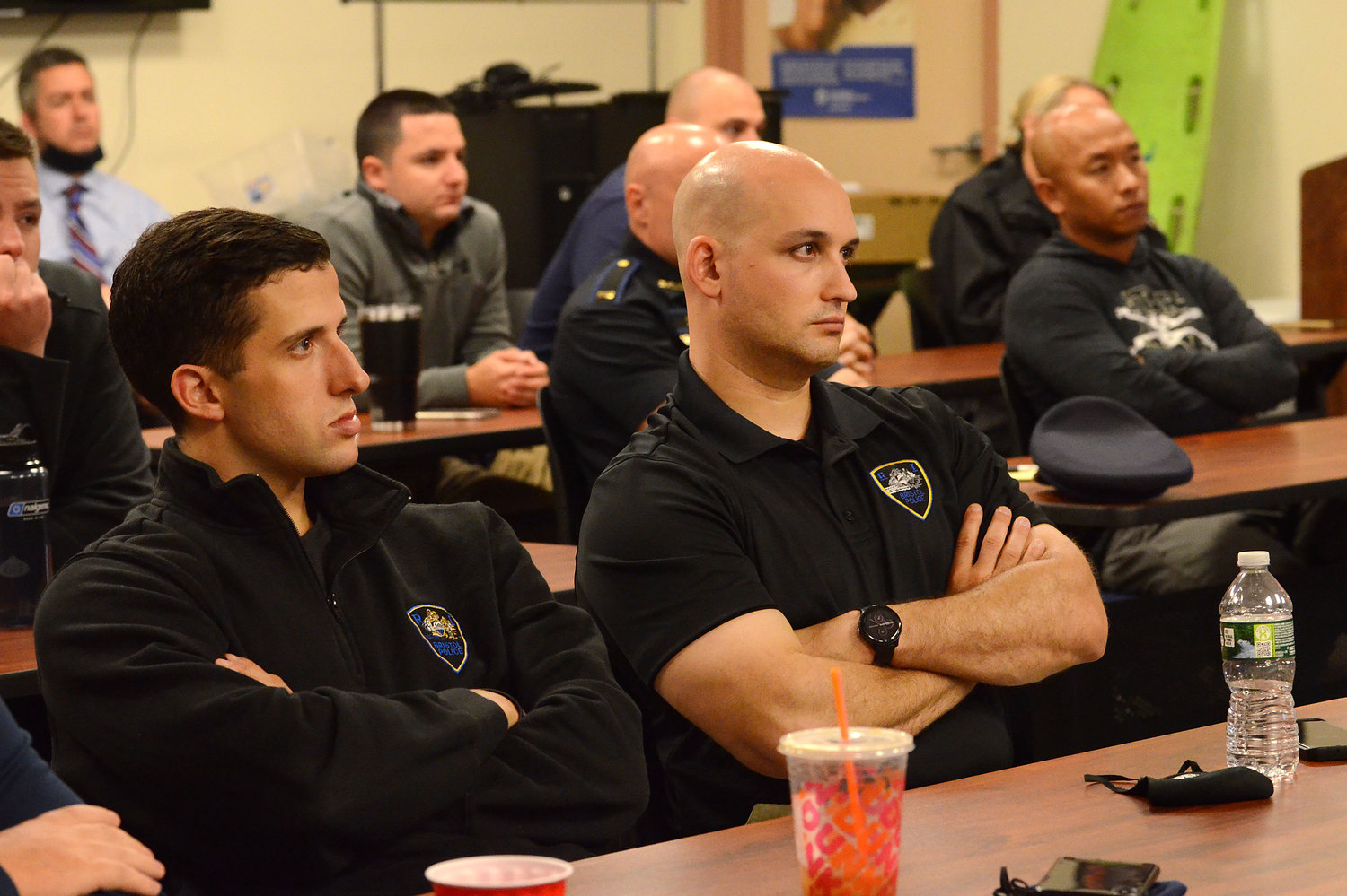 Bristol police officers (from left) Adam Almeida and Alex Booth look on as state troopers conduct a diversity training for the department on Wednesday.