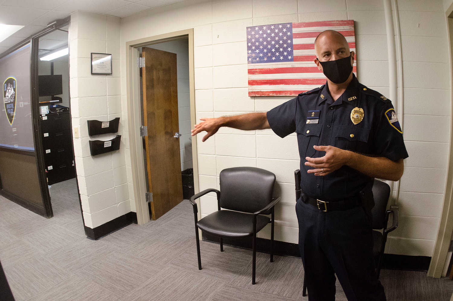 Capt. Brian Burke shows some of the building improvements, including new carpeting, all done in-house by officers.