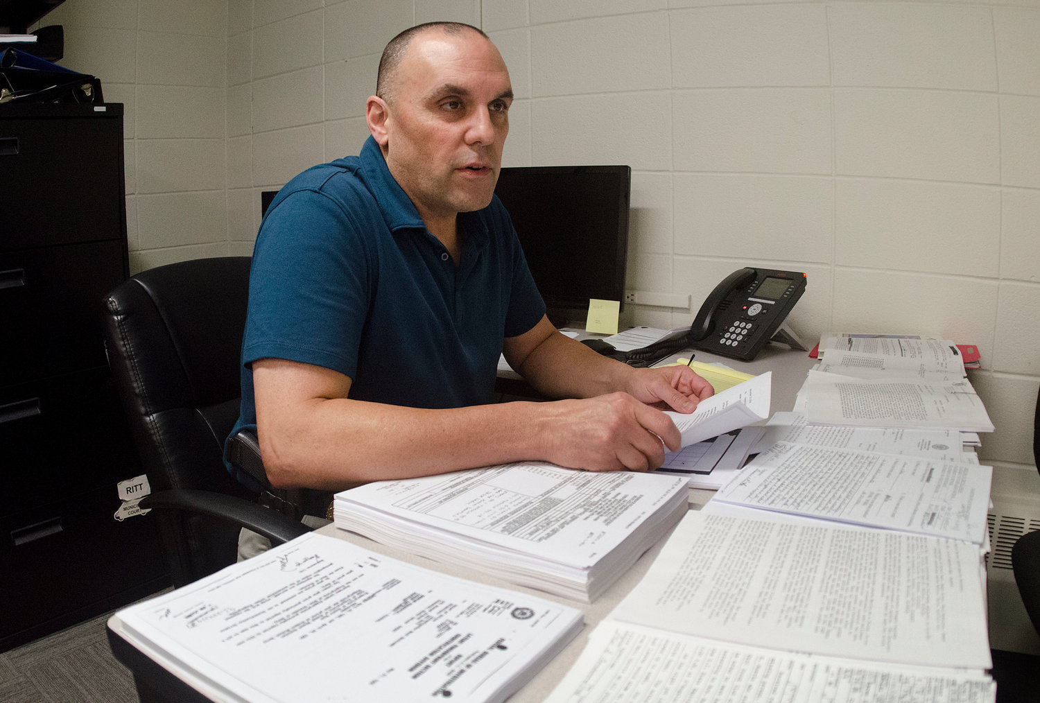 Ptlm. George Lefebvre is temporarily driving a desk instead of a cruiser, as the drop in calls permits him to turn his attention to the department's cold case files.