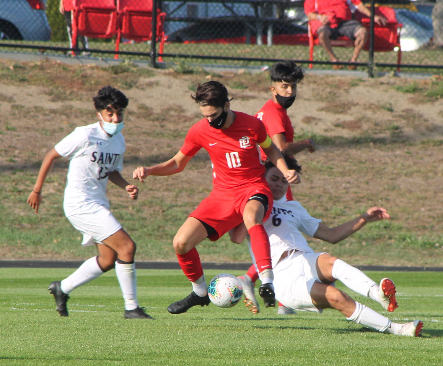 EPHS senior captain Colin Capelo dribbles in traffic against St. Raphael players during the teams' season opening Division I boys' soccer outing Saturday, Oct. 10.