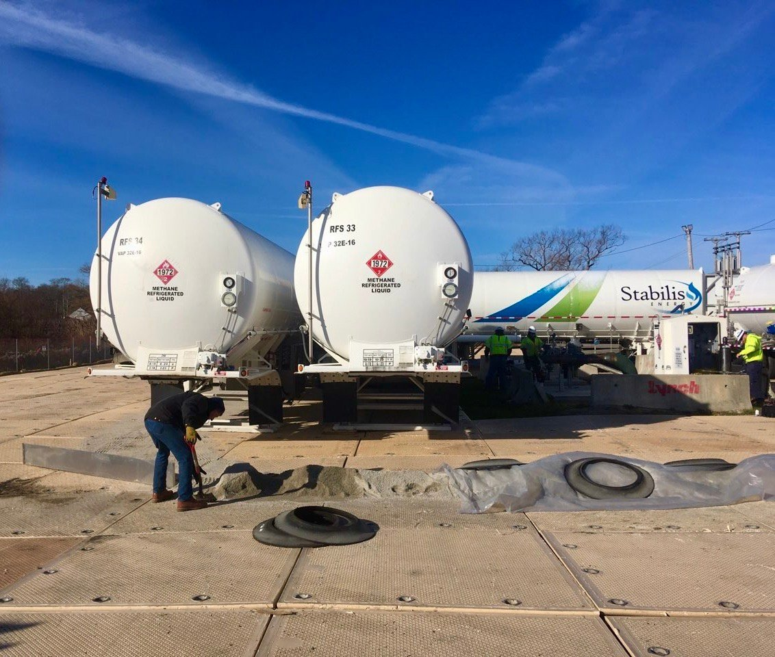 File photo of tanker trucks filled with liquefied natural gas at a temporary storage facility on Old Mill Lane, within a residential neighborhood.