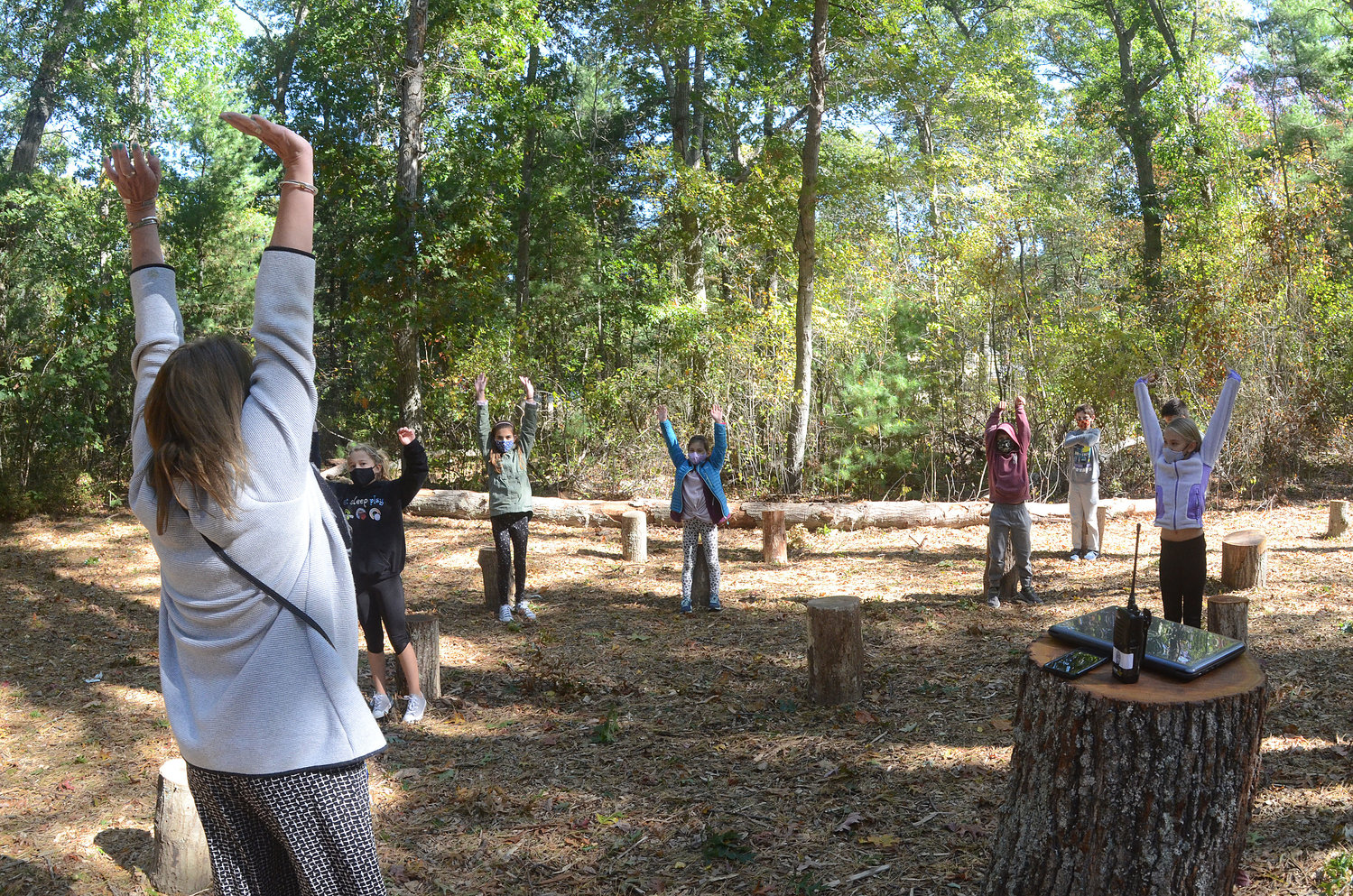 Hampden Meadows School Principal Tracey McGee leads students in yoga exercises in one of the outdoor classrooms.