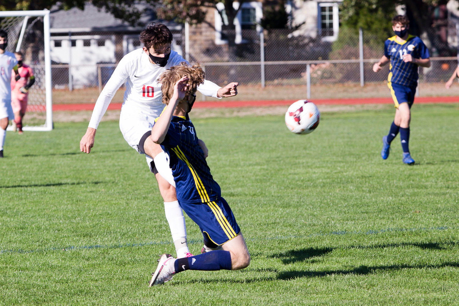 Colin Capelo boots the ball past a Barrington defender.