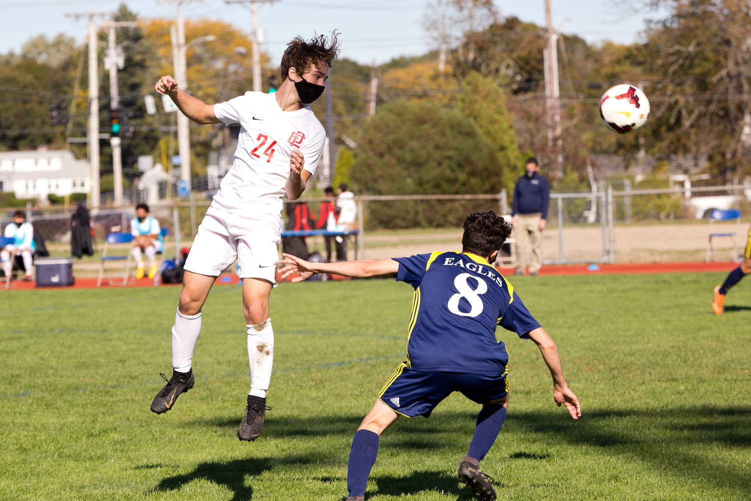 Andrew Jackson heads the ball over a Barrington opponent.