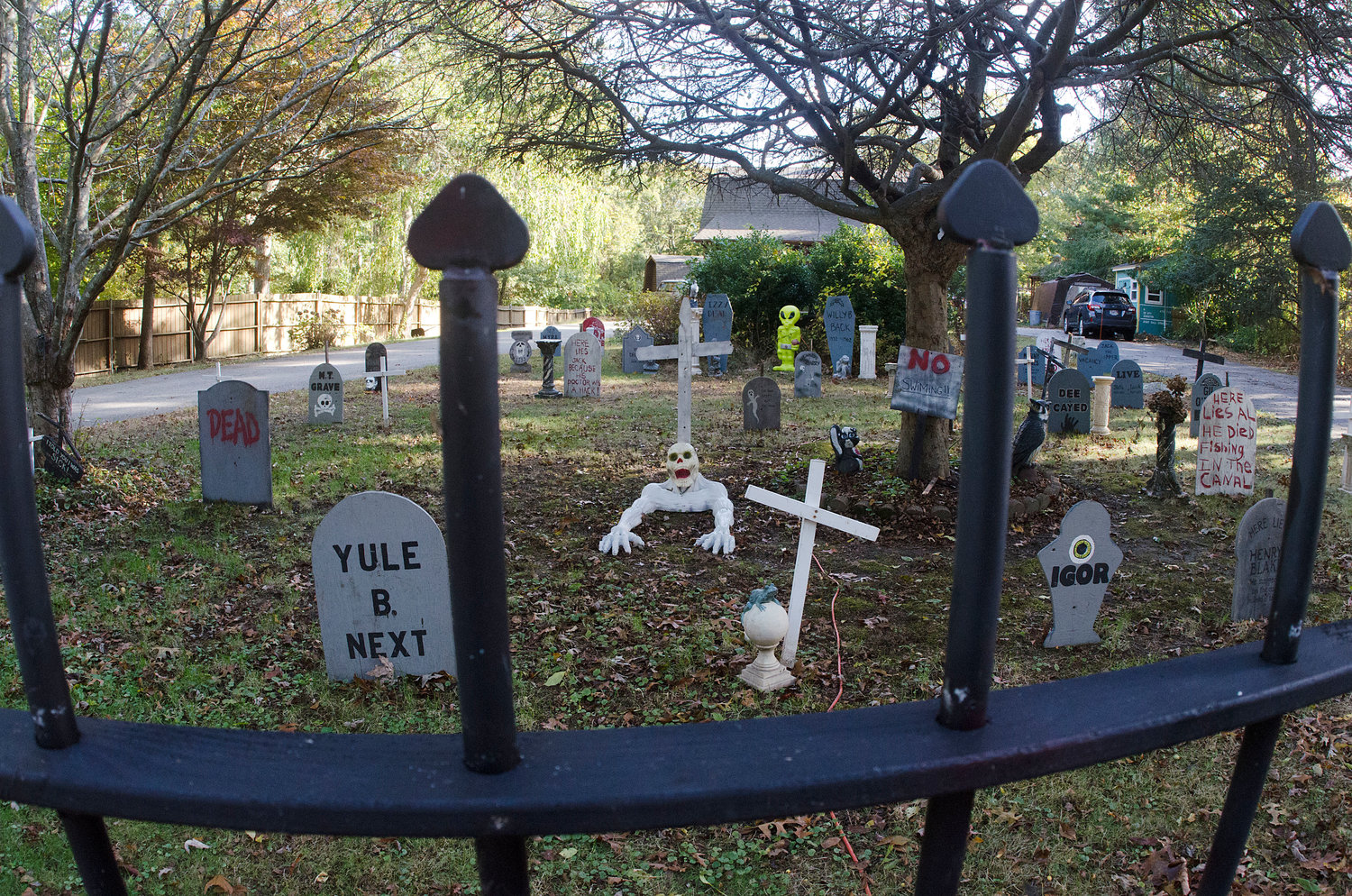 The yard at 97 Bucks Way, Tiverton, is transformed into a haunted graveyard.