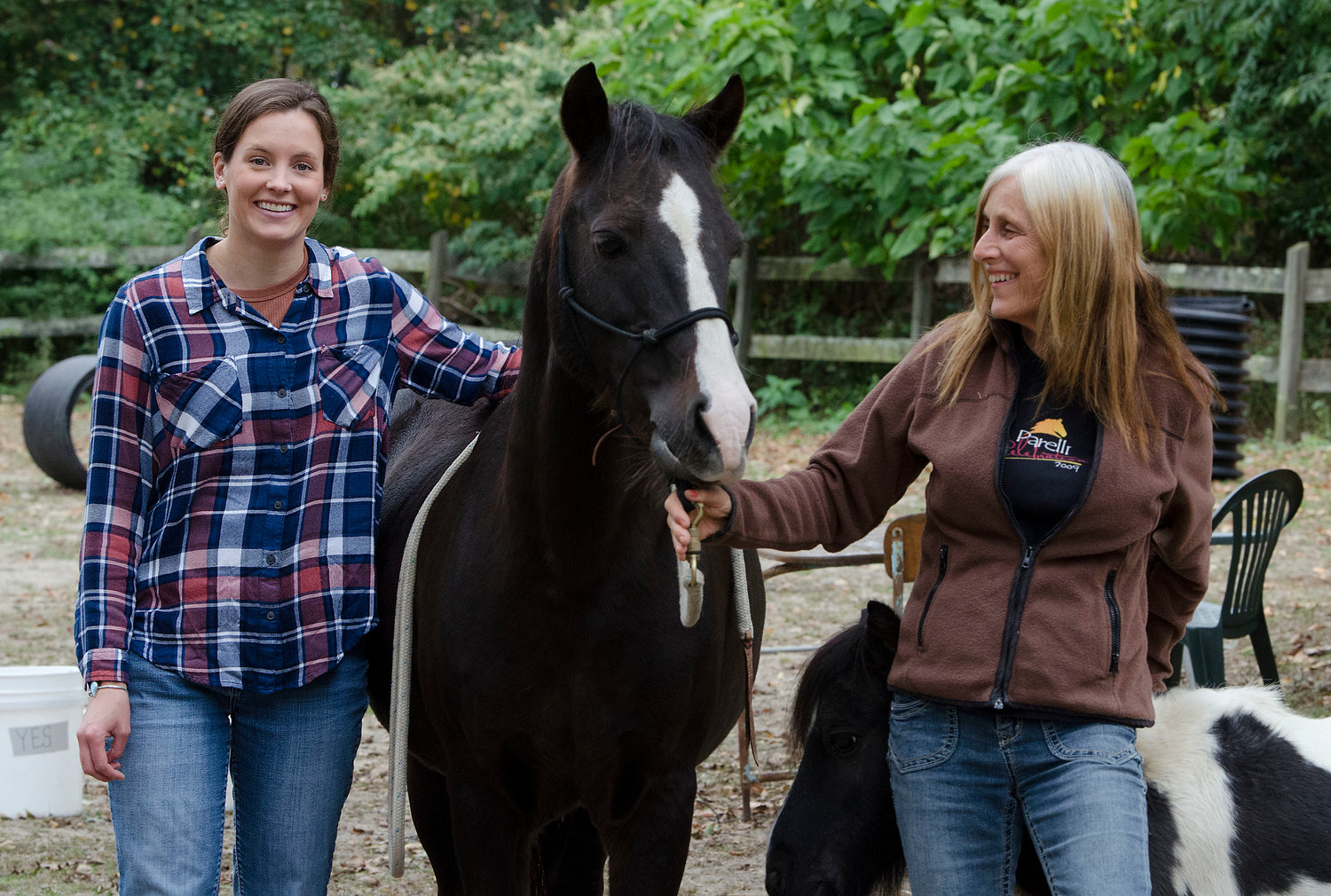 Jessica Veroline (left), a mental health professional, and Carol Ann Silva, who runs Medicine Horse equine therapy center, work together to pair those in recovery or treatment with horses who can play a critical role.