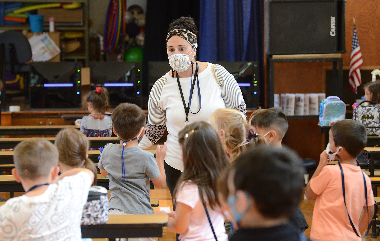 A teacher works with students at the Macomber School during the first week of school in September.