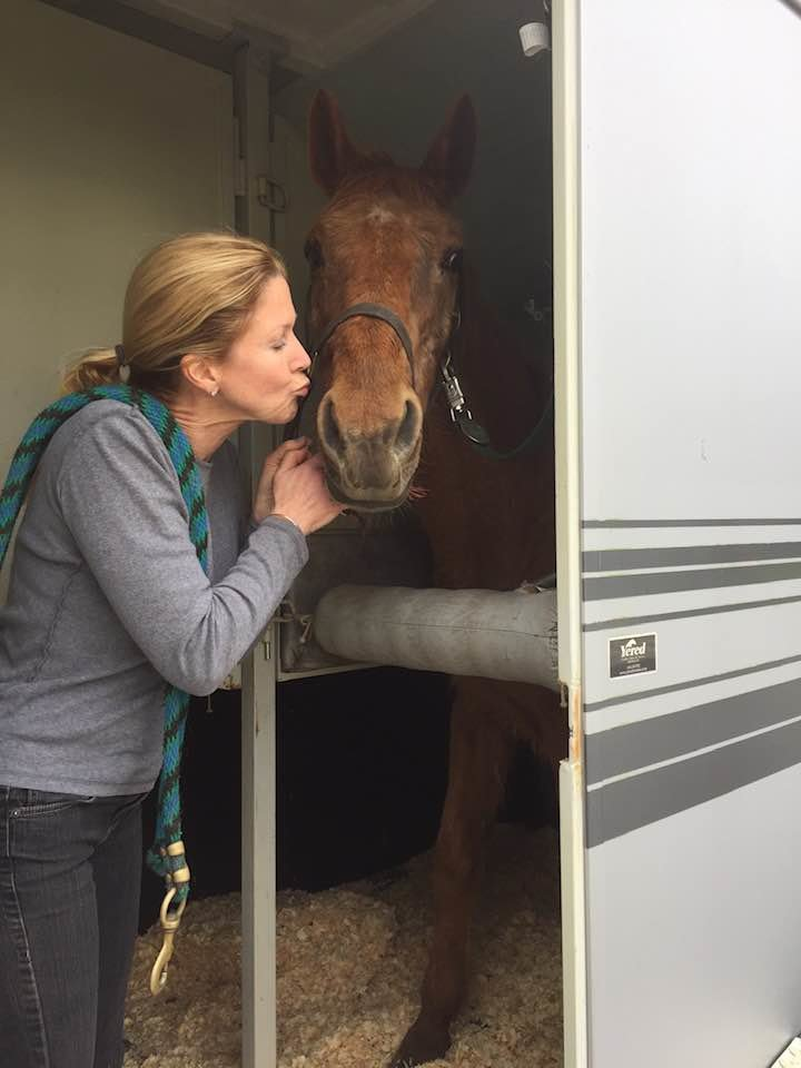 The letter's author, Amy Rice, kissing her horse Reina.