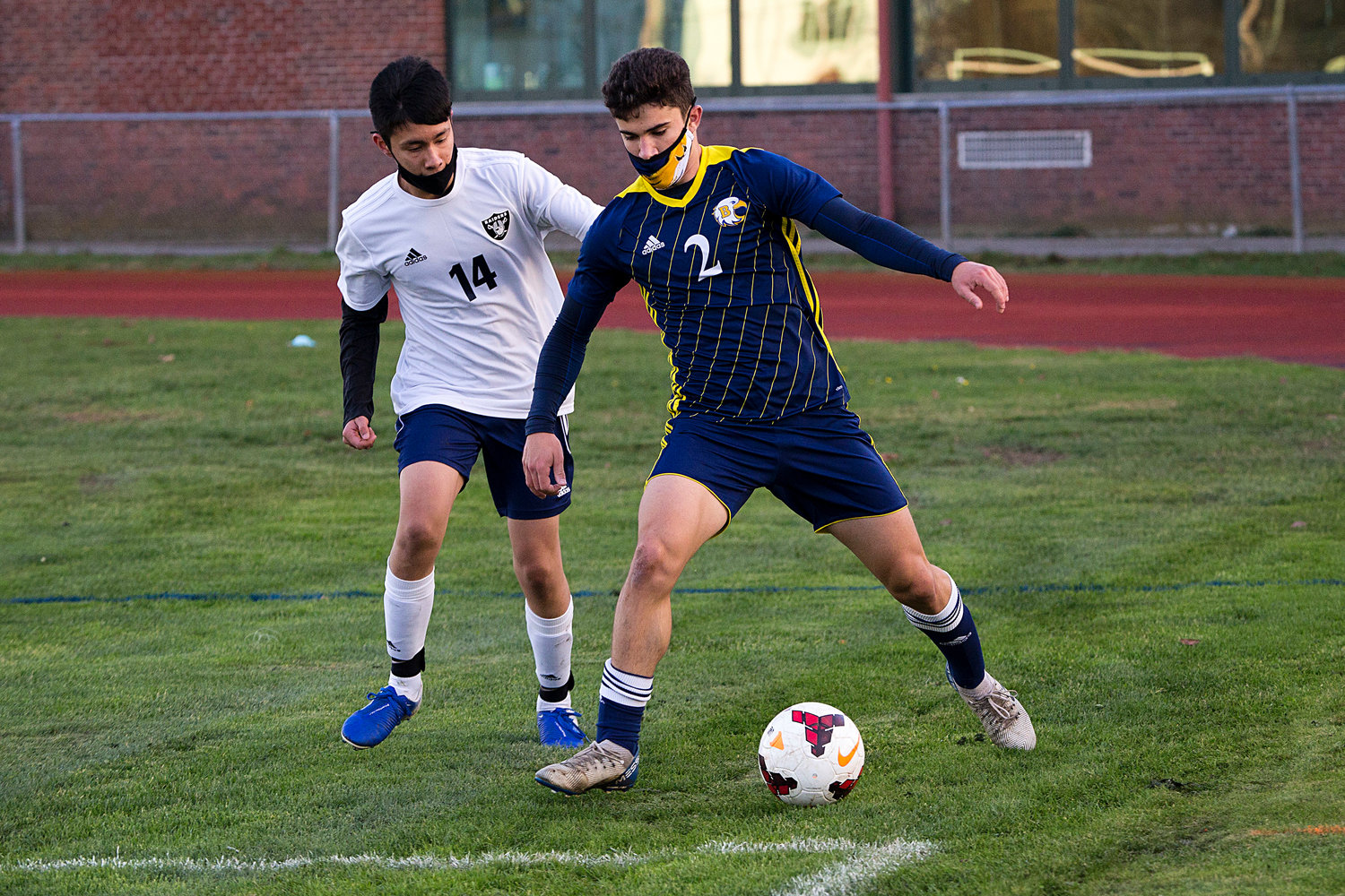 Nico Arce shields the ball from a Shea opponent while keeping it in play, at the corner. Barrington lost to South Kingstown in a playoff game on Monday.