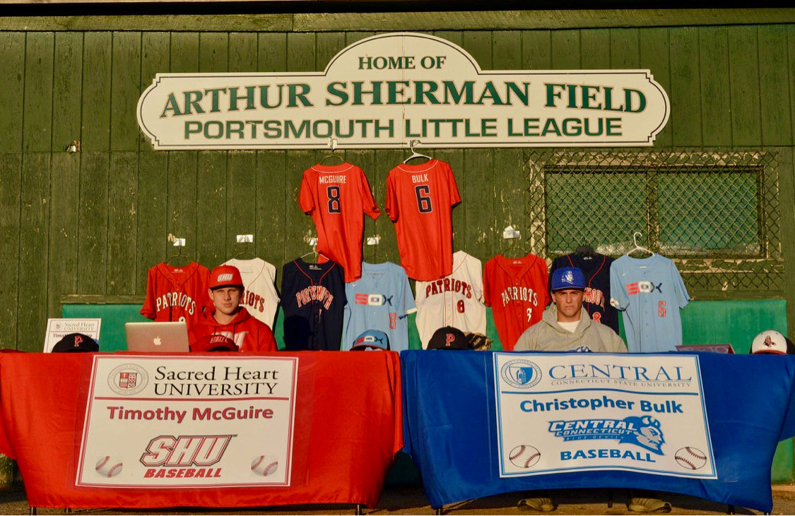 Tim McGuire (left) and Chris Bulk prepare to sign their letters of intent Monday to play baseball next year for Sacred Heart University and Central Connecticut State University, respectively.
