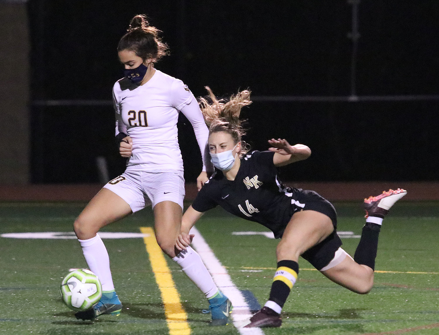 Barrington High School senior forward Tess Gagliano steadies as a North Kingstown defender falls trying to stop her on a through pass up the middle in the first half of the quarterfinal game on Tuesday night at North Kingstown.