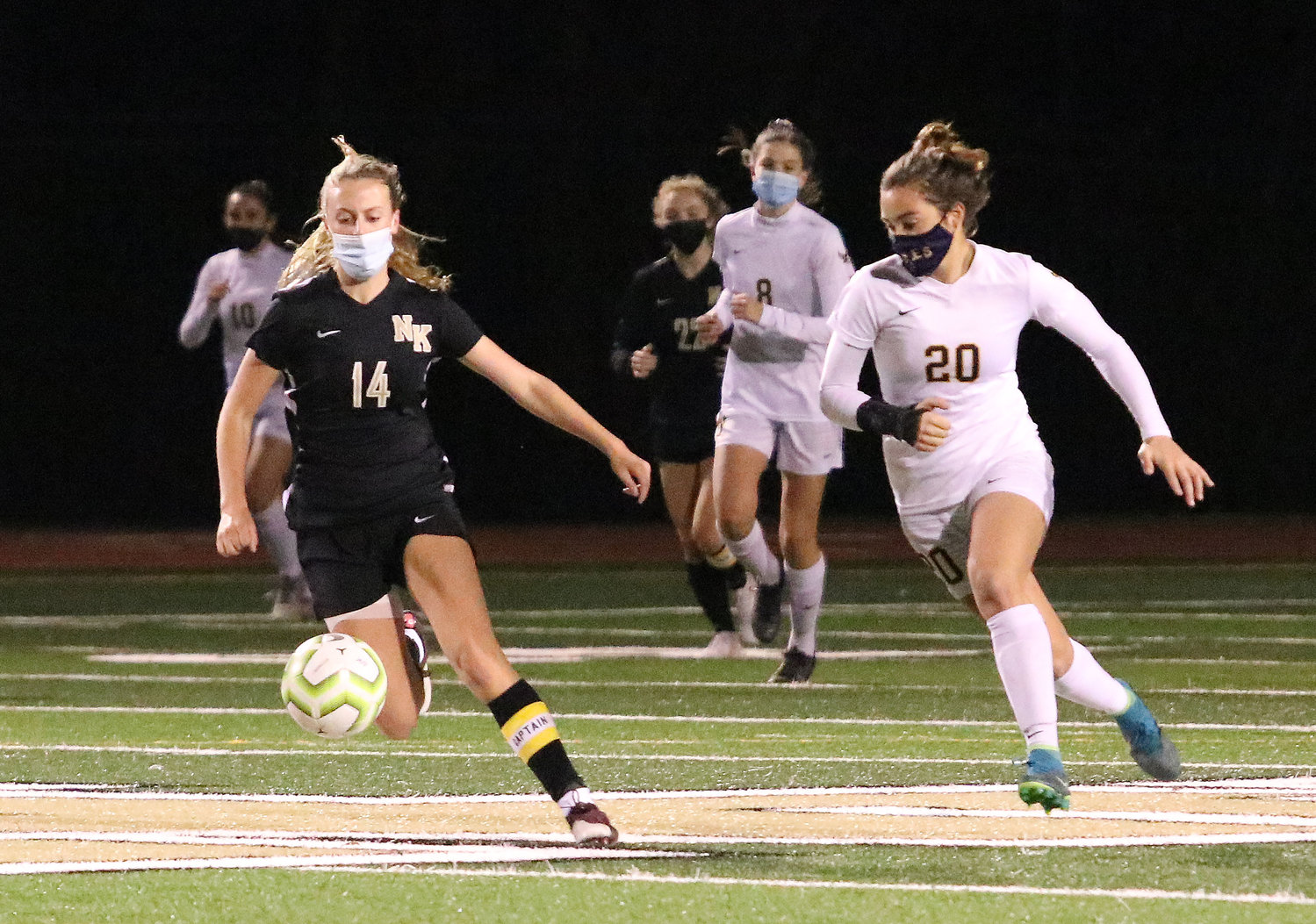 Tess Gagliano (right) runs after an Eagles' goal kick during the playoff game on Tuesday at North Kingstown.