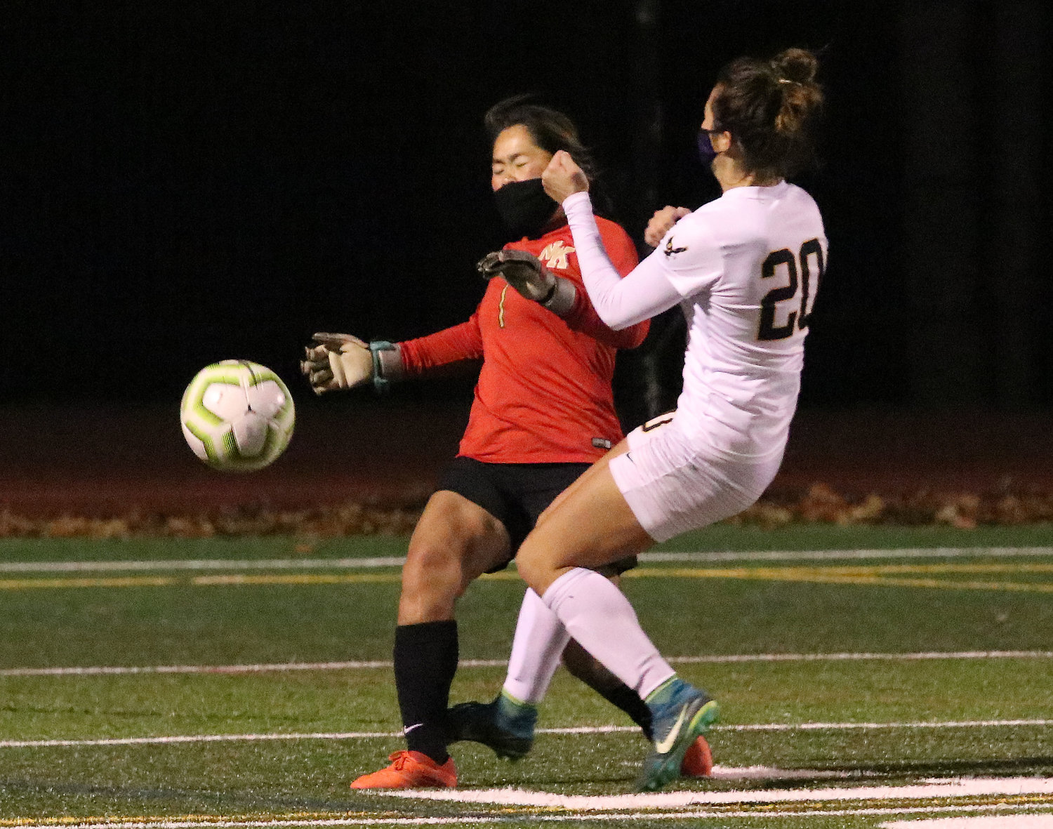 Tess Gagliano runs into the Skippers' goalkeeper during an Eagles scoring bid.