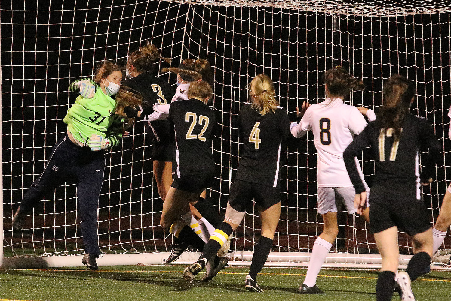 Eagles goalkeeper Alaina Wood (left) bats the ball out during a Skippers' corner kick.