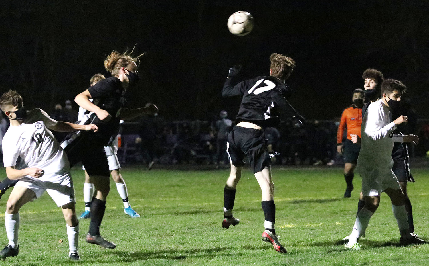 Tristan Tamuliates (left) heads the ball into the Pilgrim goal to give the Huskies an early 1-0 lead in the first half.