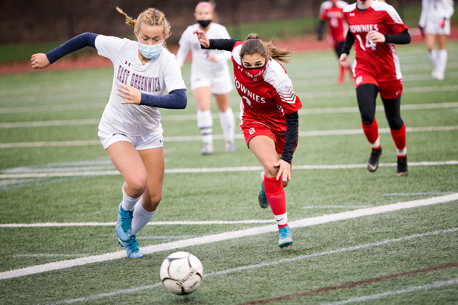 Hailee Manteiga races an East Greenwich opponent to a loose ball during Sunday's Division II finals game, in Johnston.