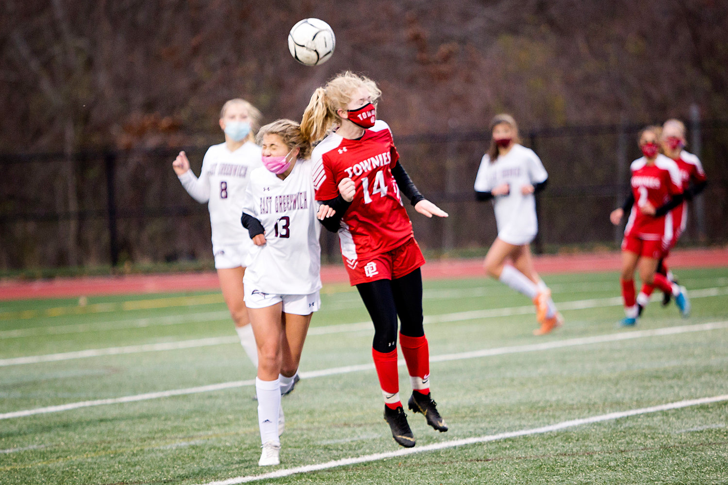 Lily Budnick battles goes up, for a head-ball against an East Greenwich opponent.