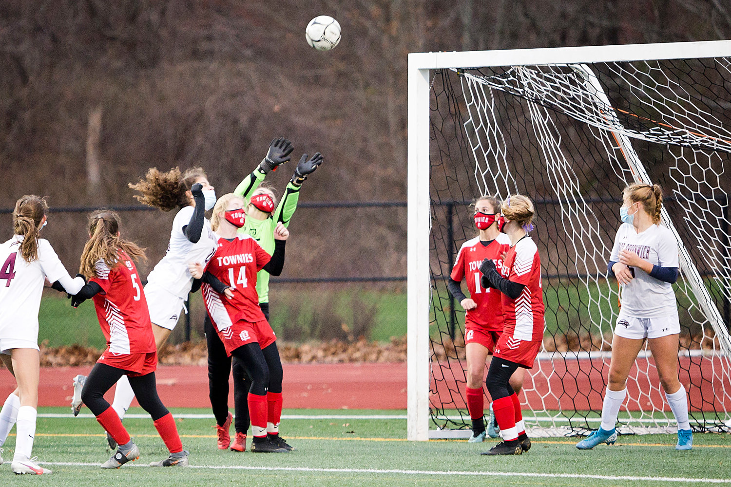 Goalie Kay Lee Davenport reaches to stop a corner kick during Sunday's Division II finals game, in Johnston.