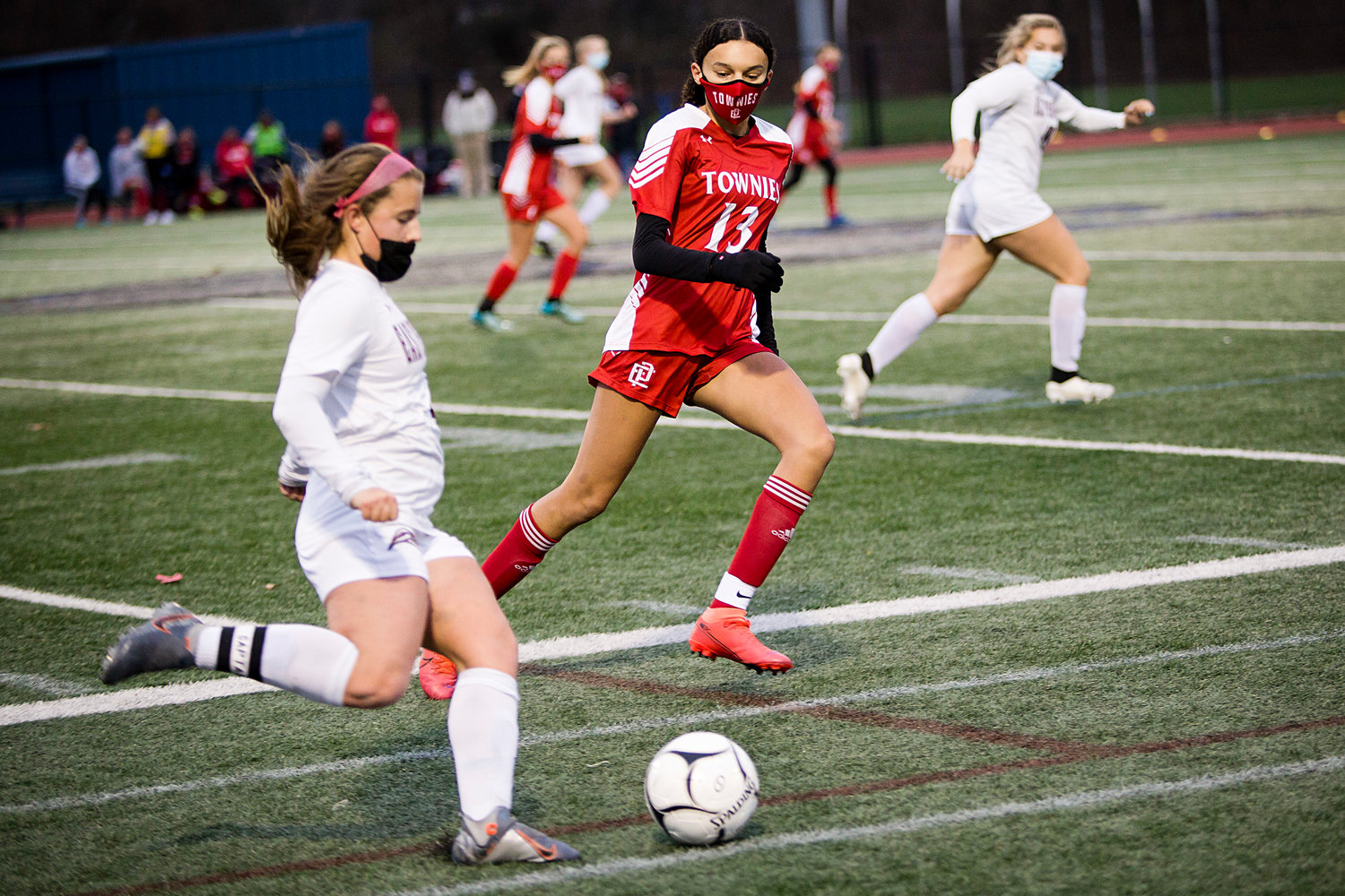 McKayla Lopes pressures an East Greenwich opponent during Sunday's Division II finals game, in Johnston.