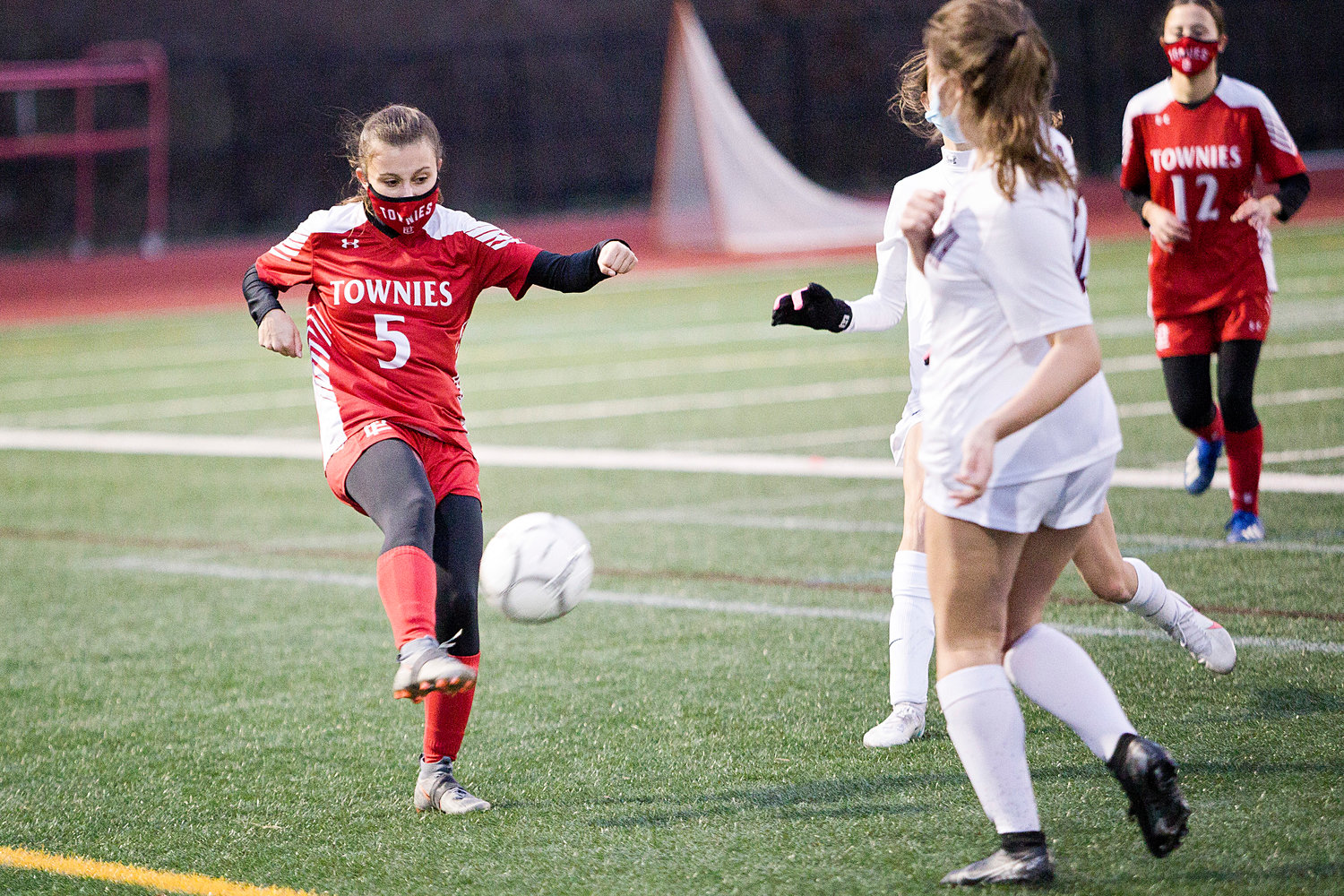 Tessa LaRoche attempts to pass the ball past a pair of East Greenwich opponents