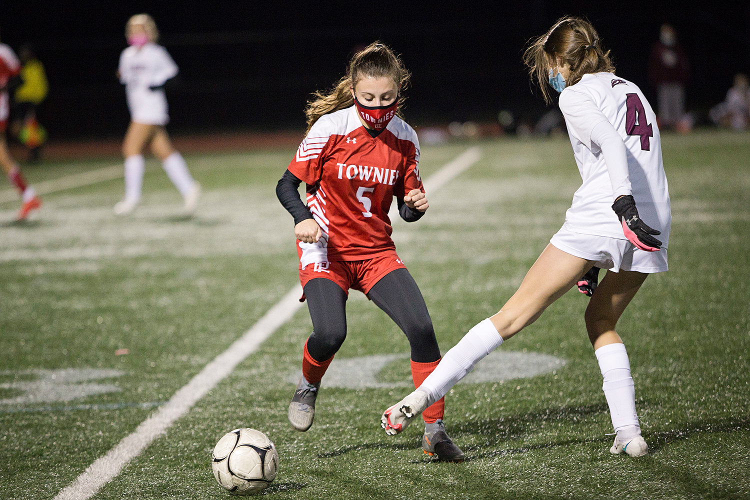 Tessa LaRoche tries to maintain possession of the ball while pressured by an East Greenwich opponent.