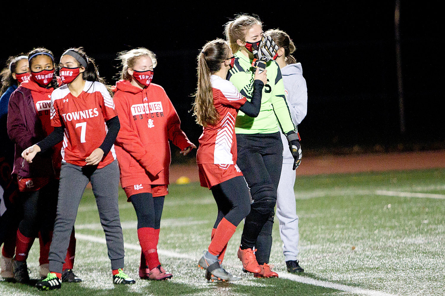 Emily Gorski (left) and teammates console goalie, Kaylee Davenport after the Townies fall 3-2, to East Greenwich in overtime of the Division II Finals, Sunday.