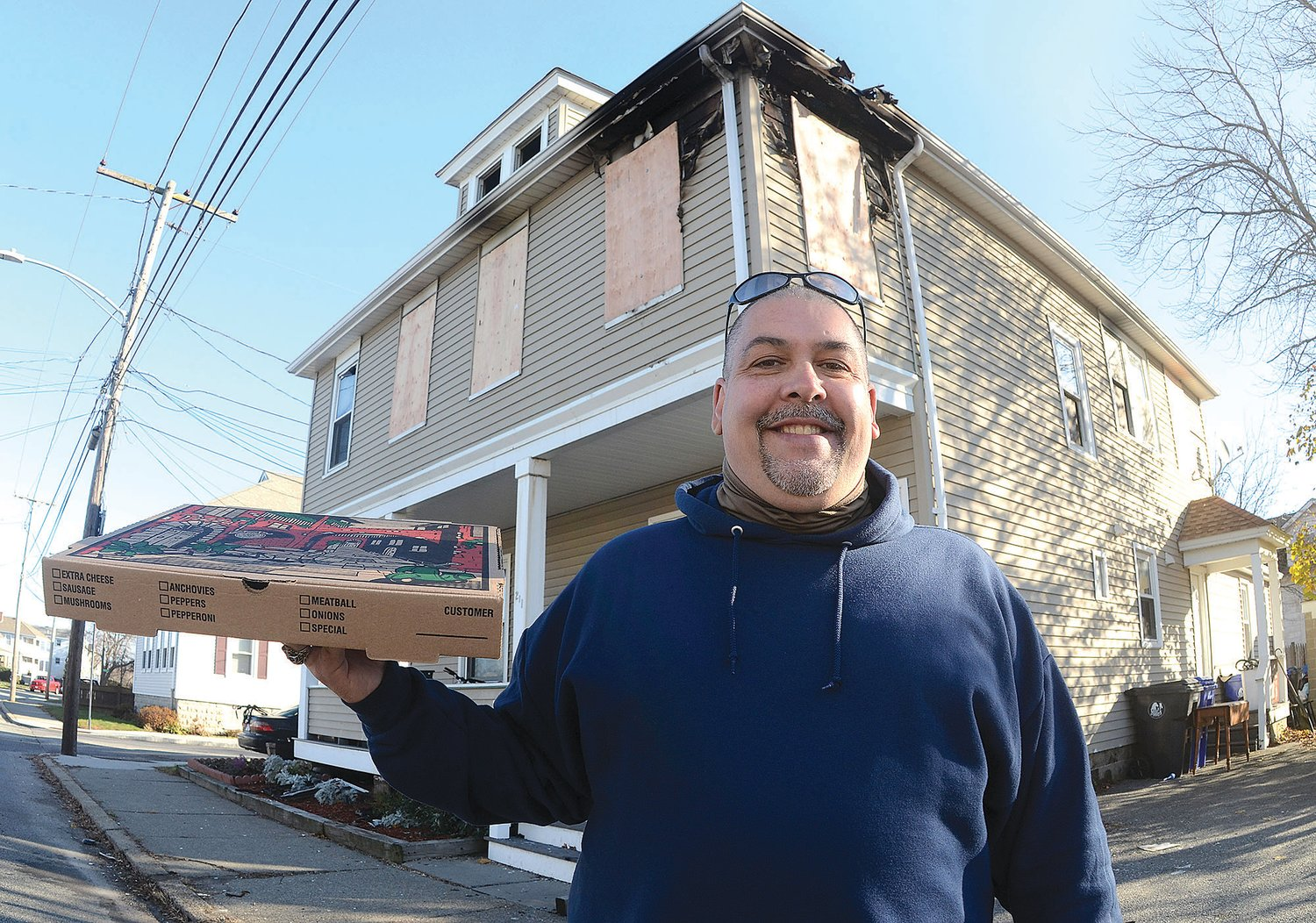 Carl DaPonte was delivering a pizza to this apartment building in Warren Saturday night at the same moment as a fire was spreading through the building. He dashed upstairs to help a man who was asleep on the second floor.