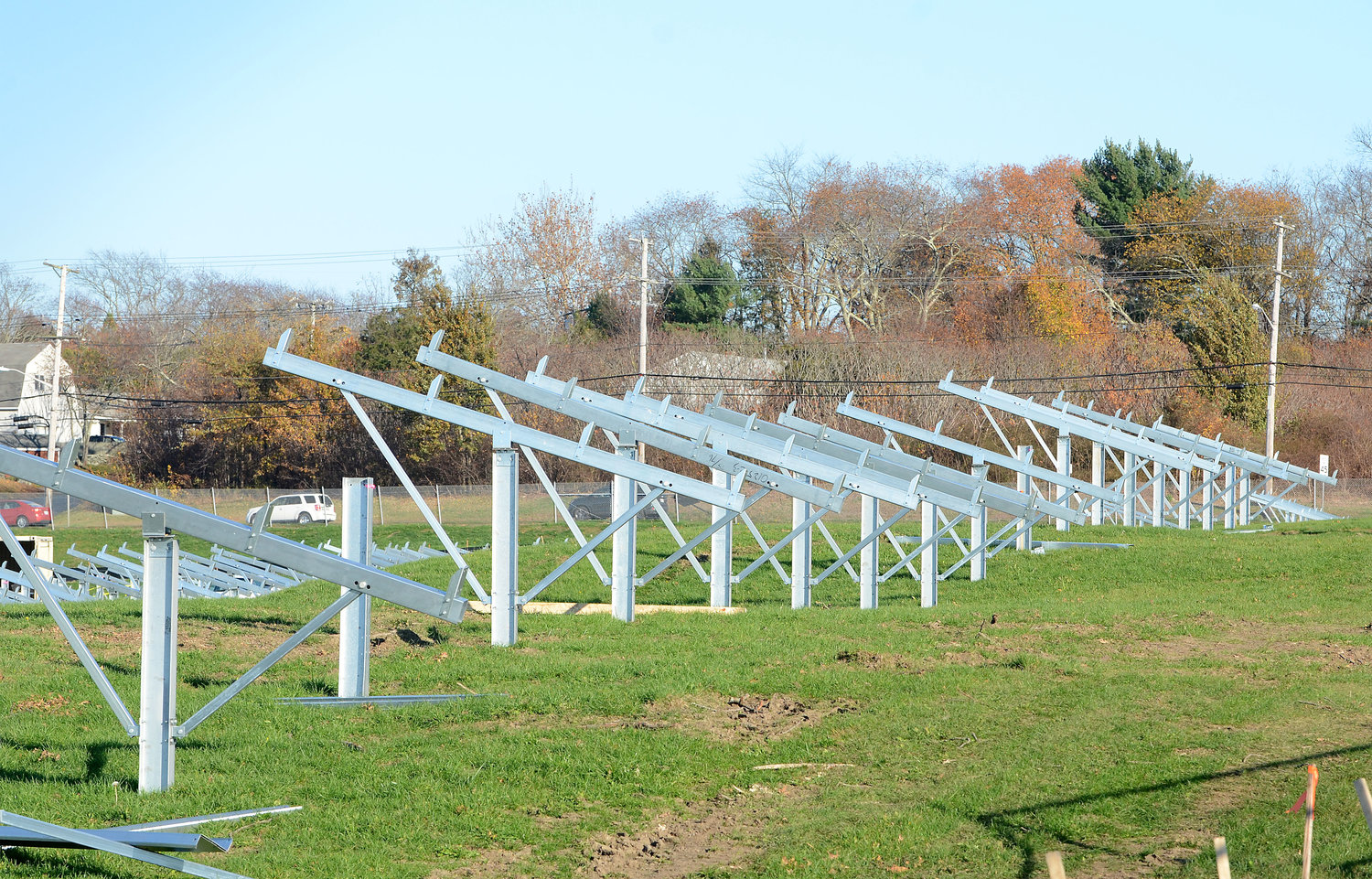 "The unsightly solar array being erected by the U.S. Navy along West Main and Stringham roads brought ""the issue to the forefront,"" according to Town Council member Daniela Abbott, while local resident Robyn Younkin called it ""a warning to all of us."" The town had no say in the federal project's development."