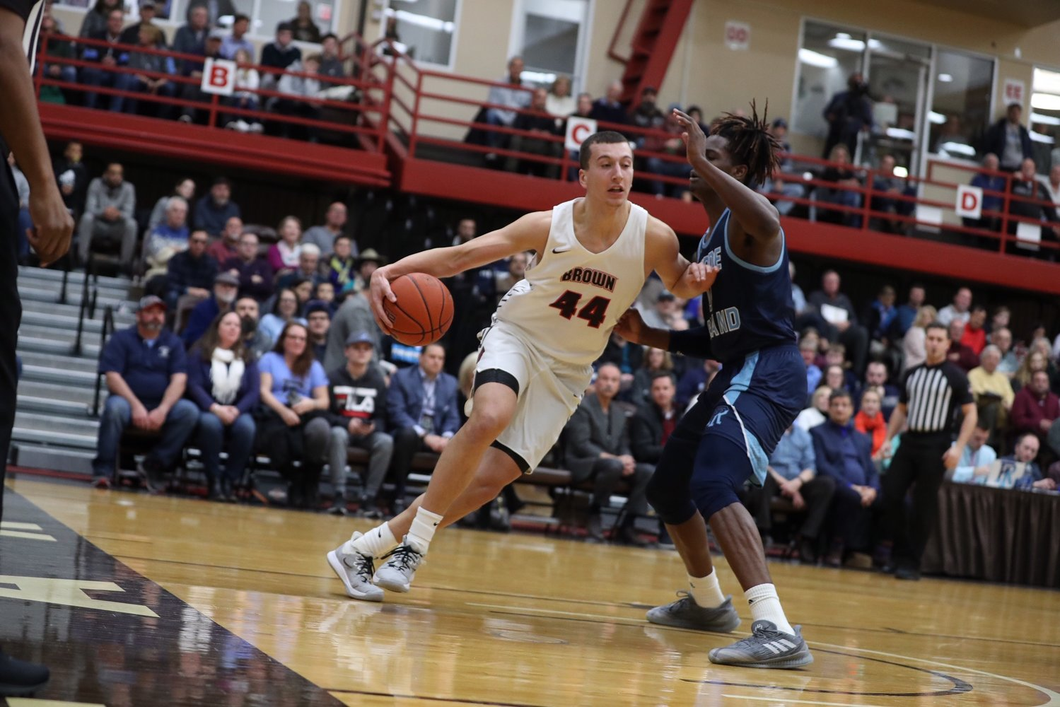 Brown University's Matt DeWolf drives to the basket during a game against URI. Matt starred at Barrington High School and later at Northfield Mount Hermon before heading to Brown University.