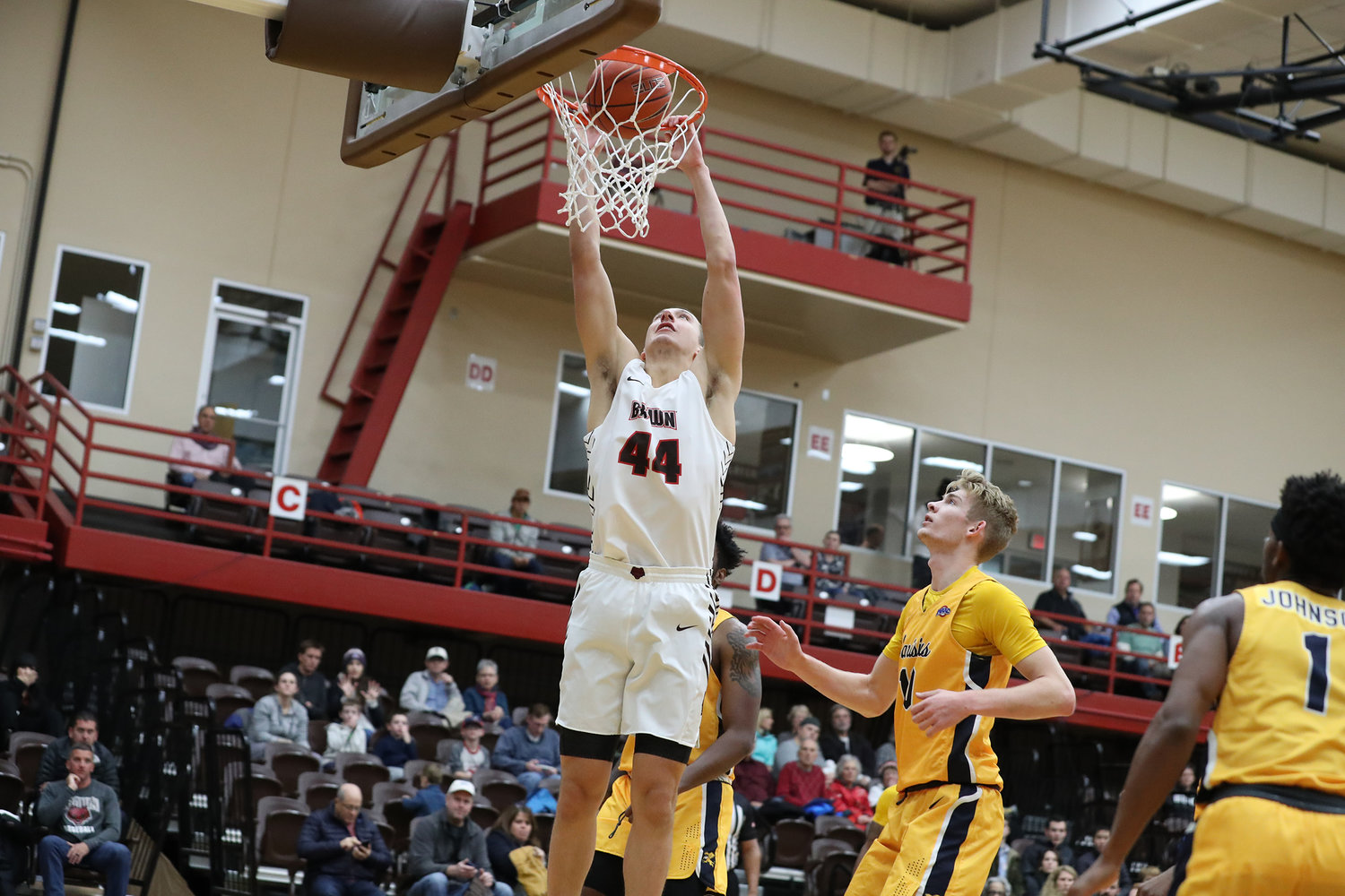 Brown University's Matt DeWolf only started playing organized basketball in the eighth grade. He later starred at Barrington High School and Northfield Mount Hermon.