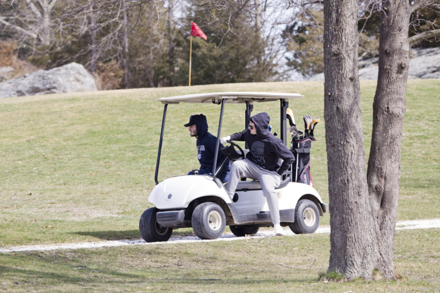 Duffers zip around the Windmill Hill golf course this past March.