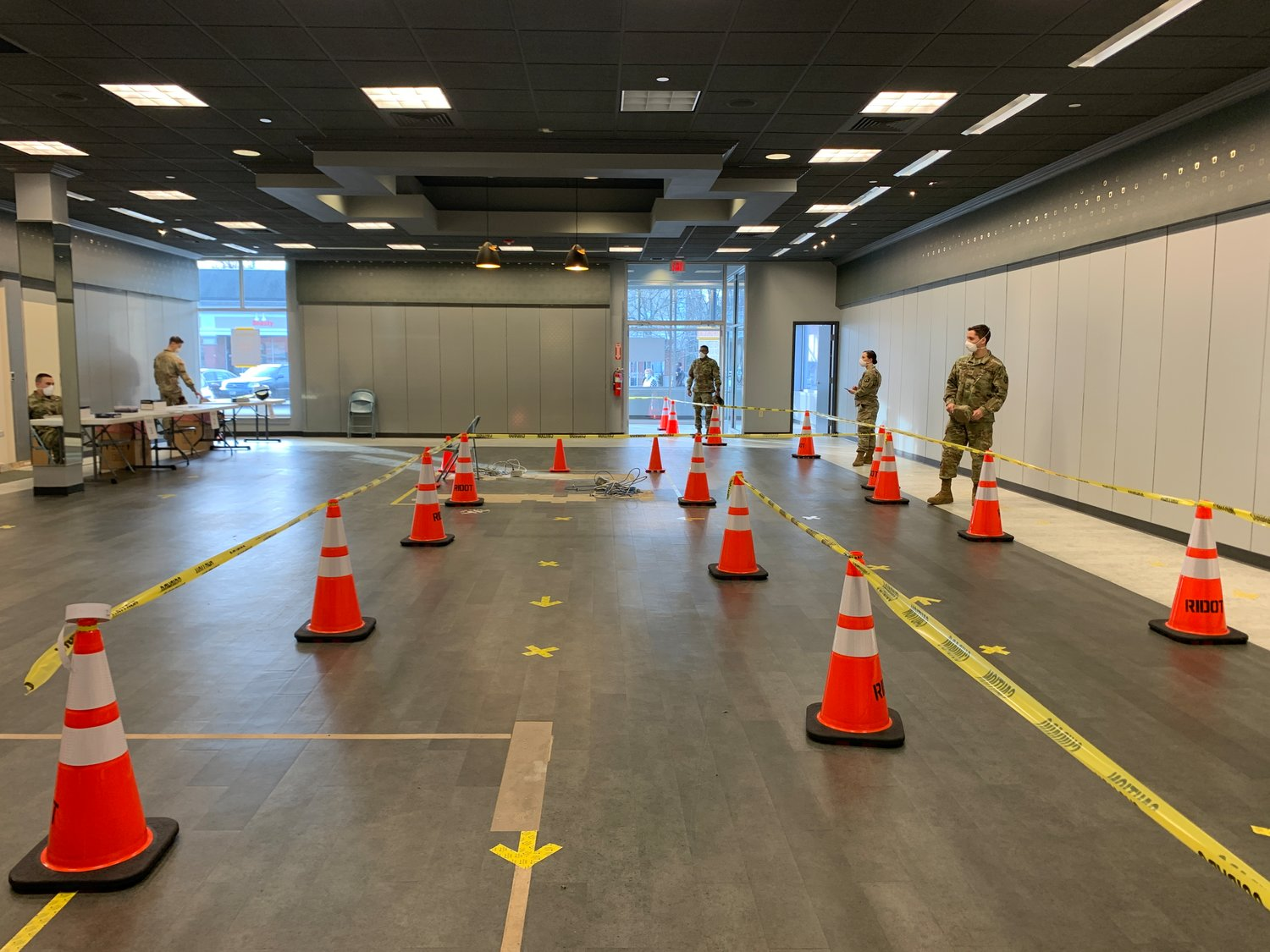 Members of the RI National Guard set up the asymptomatic rapid testing site in the Barrington Shopping Center on Tuesday morning.