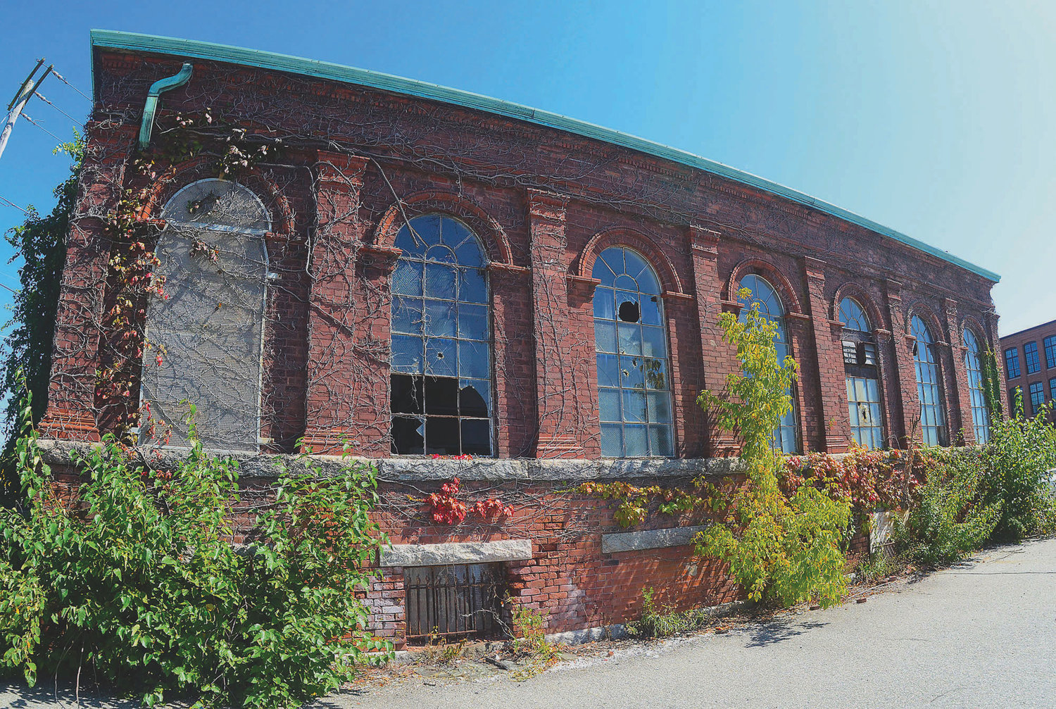 The old brick warehouse at the town-owned former National Grid site in North Warren would be used for a coffee shop and restaurant under the partners' latest plan for the site.