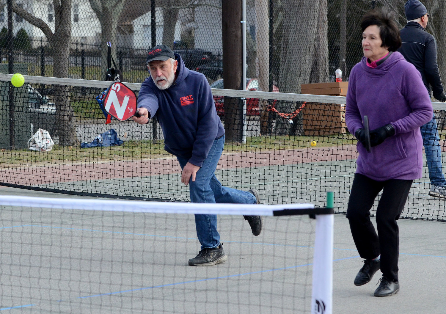 People play a game of pickle-ball in Bristol recently. Last week, the Barrington Park and Recreation Commission approved a motion to paint pickle-ball court lines on the asphalt surface at Chianese Park.