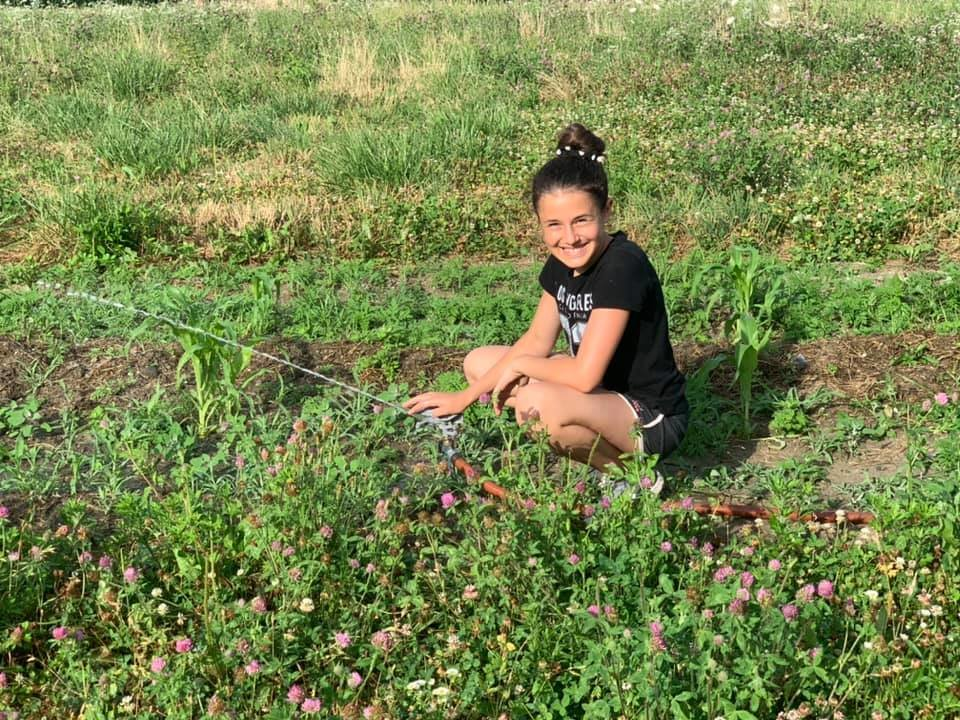 Bella Barber, an eighth-grader at Portsmouth Middle School, learns about agriculture at the AgInnovation Farm.