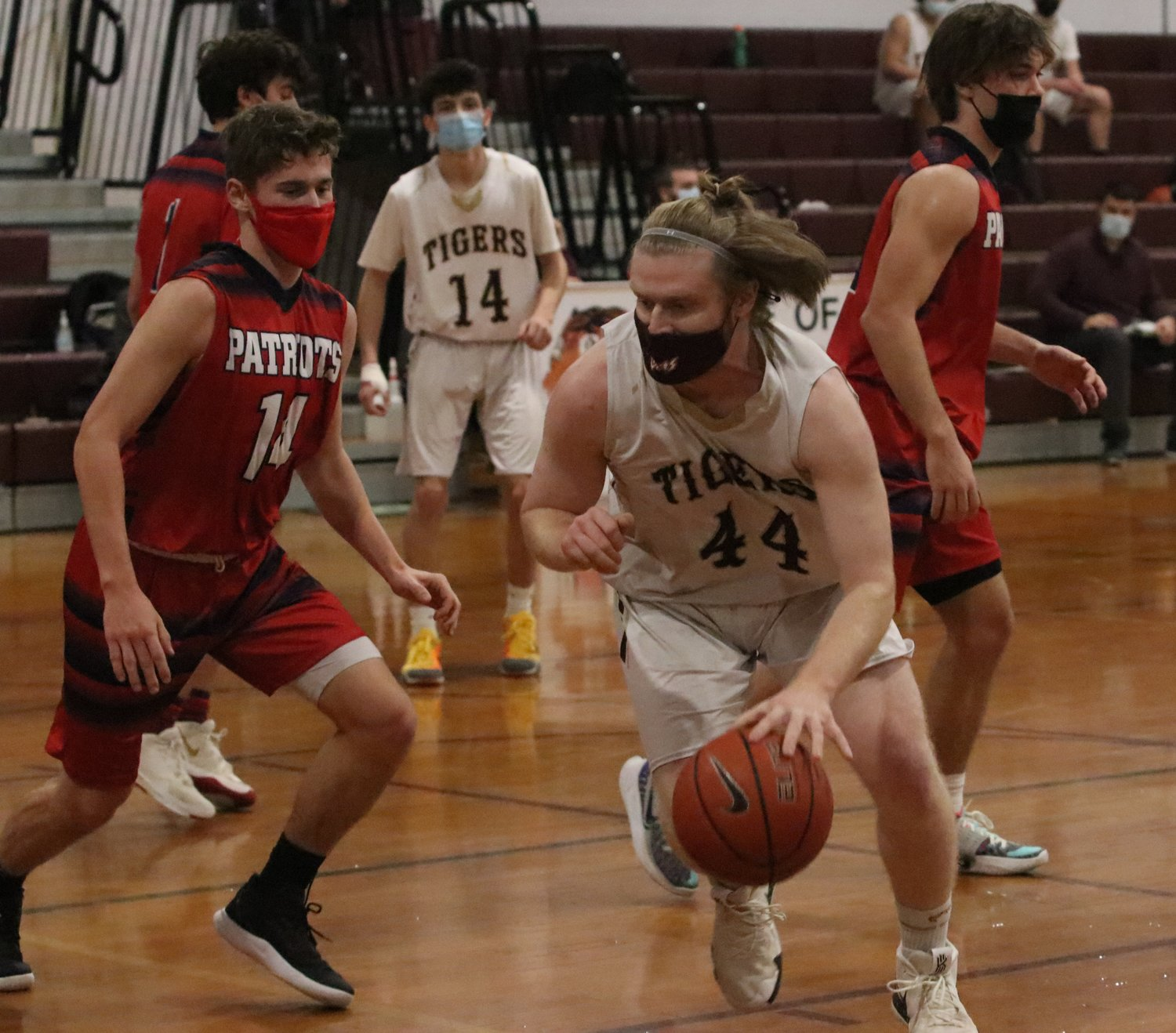Senior Will Gerlach puts the ball on the floor and makes a move to the inside.