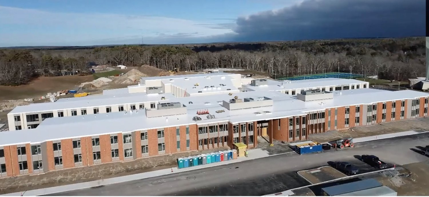 Westport's new school is still on pace to open next September, but if social distancing rules remain in effect, it probably doesn't have enough space to hold grades 5-12 as planned. A couple of grades might have to stay behind at the old school.