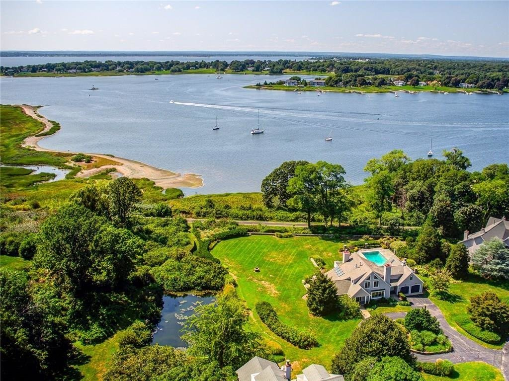 Aerial photography puts this Warren condominium in a new light. Currently on the market with Residential Properties, it is shown tucked in a private setting near the East Bay Bike Path and Narragansett Bay.