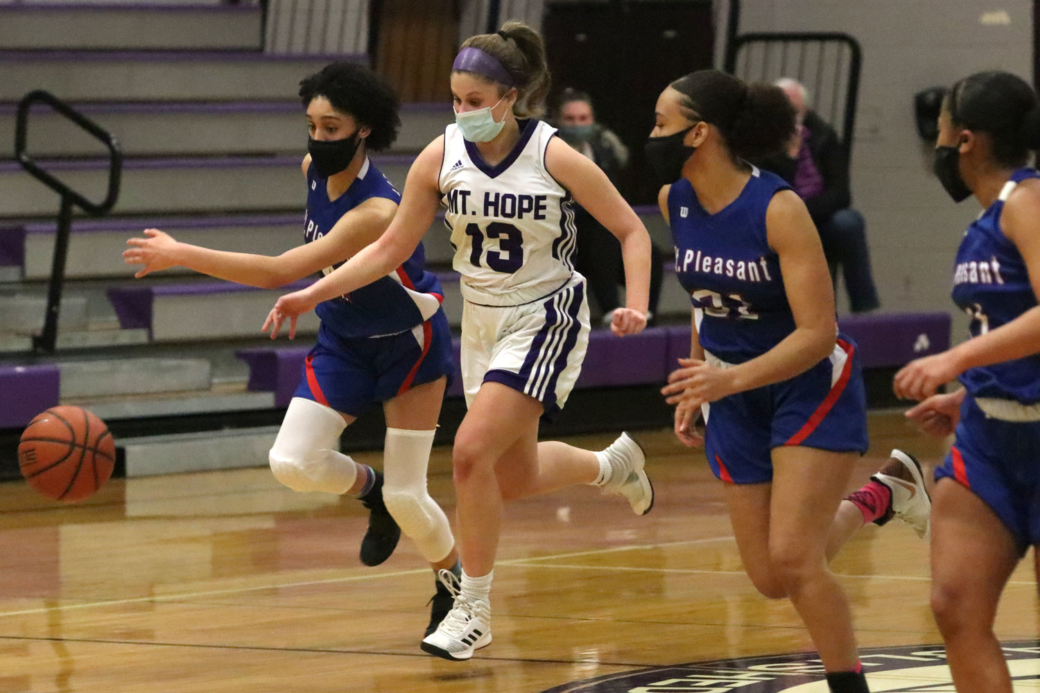 Point guard Abby Razzino dribbles up court after making a steal in the first quarter of their game against Mt. Pleasant on Thursday night. The sophomore scored 17 points in the victory.